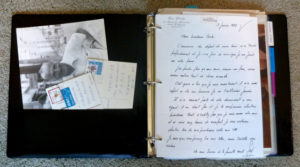 My mother's binder: a collection of photos, letters, postcards, and newspaper clippings